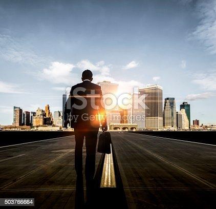 istock Businessman walking towards futuristic city 503766664