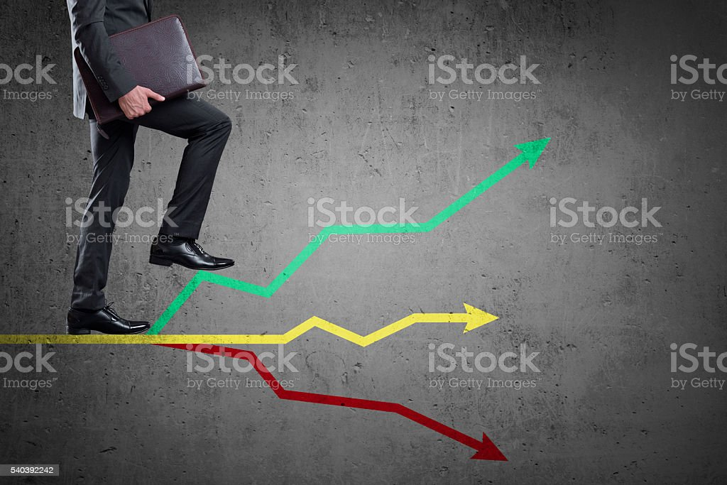Businessman walking up on colorful graph stock photo
