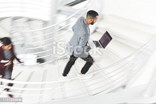 684803840istockphoto Businessman walking up stairs 1141324606