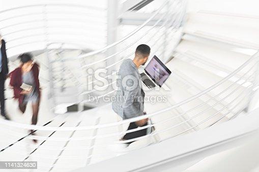 684803840istockphoto Businessman walking up stairs 1141324630