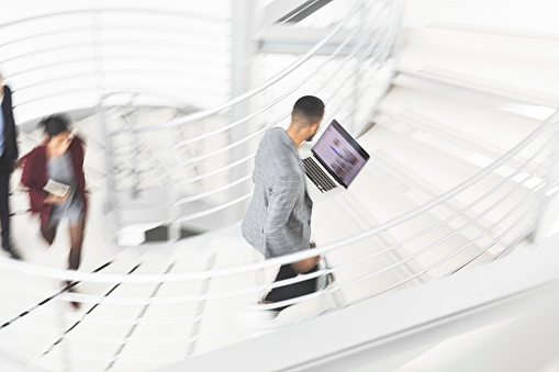 684803840 istock photo Businessman walking up stairs 1141324630