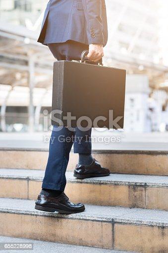 684803840istockphoto Businessman walking upward on the stair 655228998