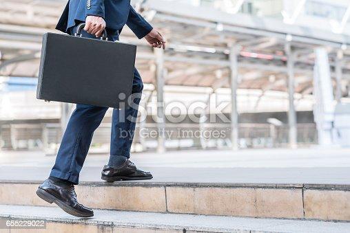 684803840istockphoto Businessman walking upward on the stair 655229022