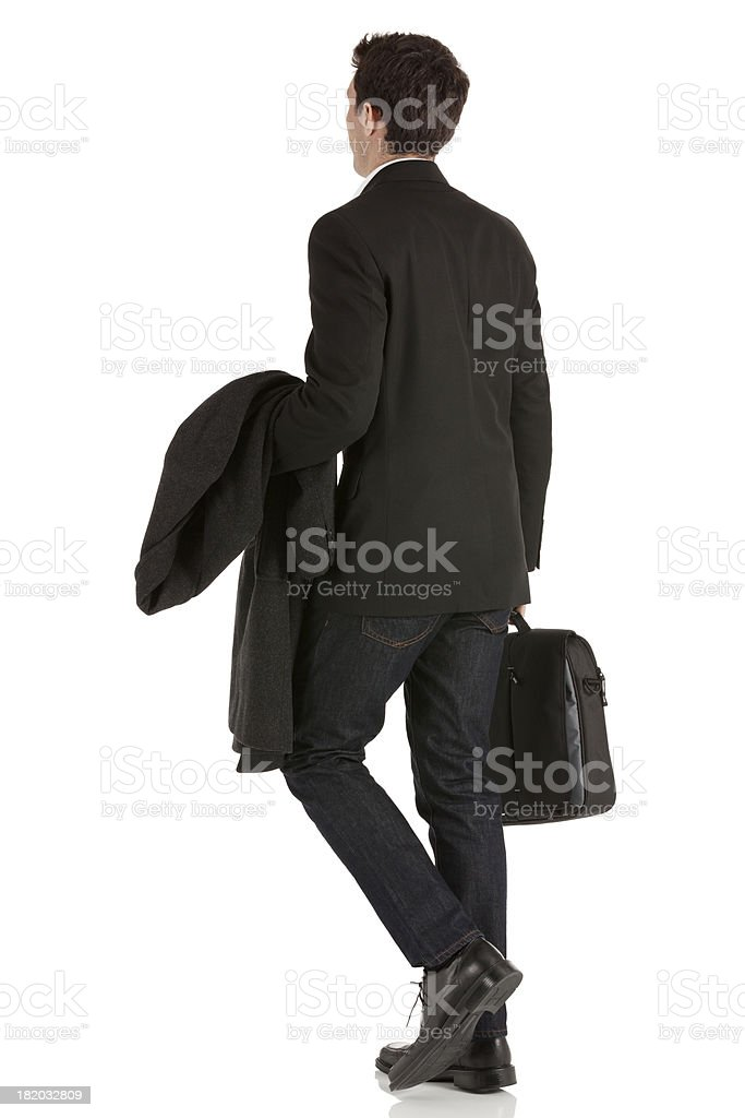 Businessman walking with a briefcase royalty-free stock photo