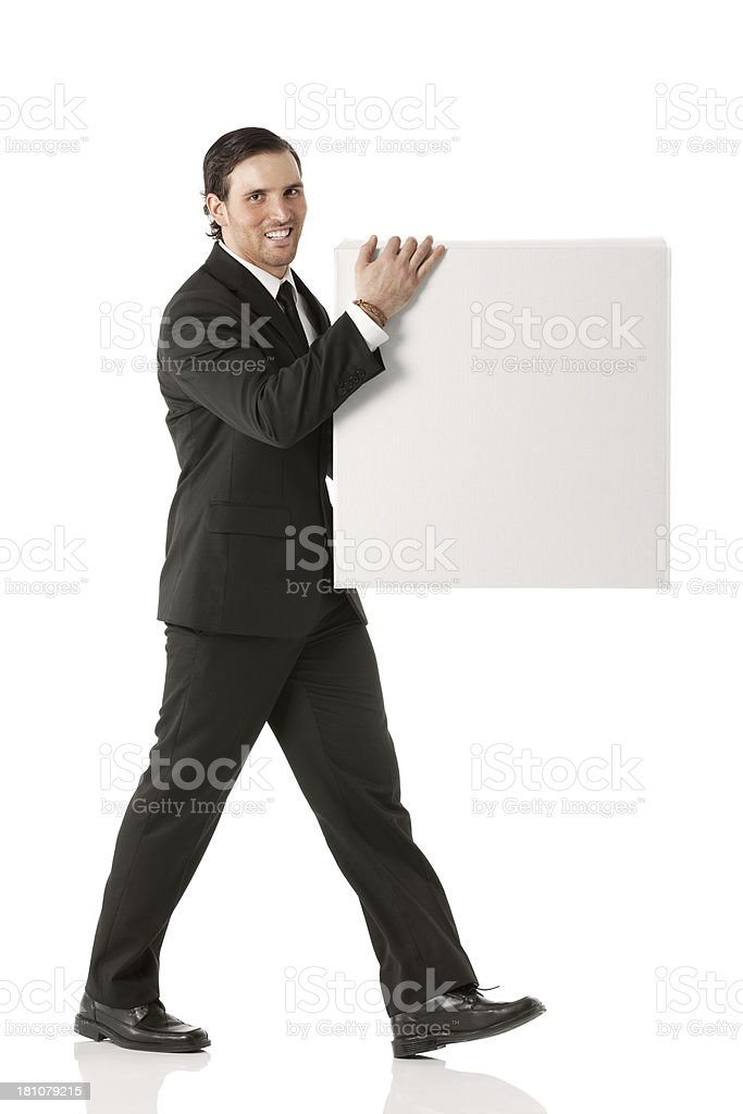 Businessman walking with a placard royalty-free stock photo