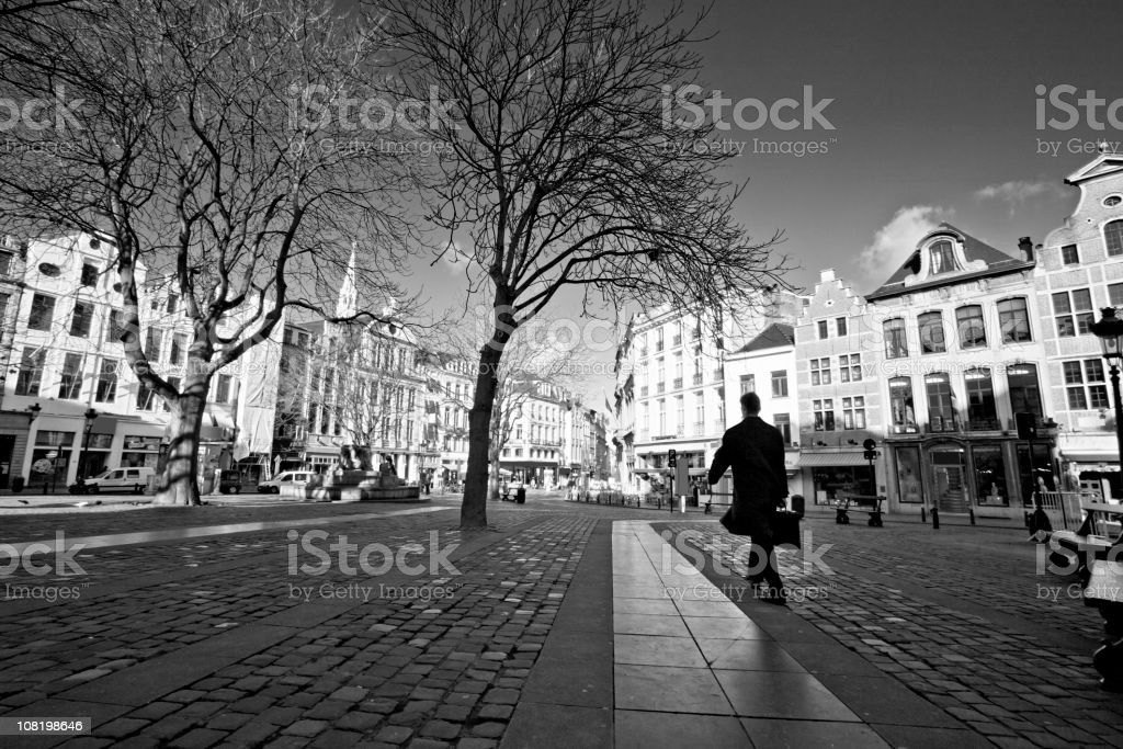 Businessman walking with briefcase royalty-free stock photo