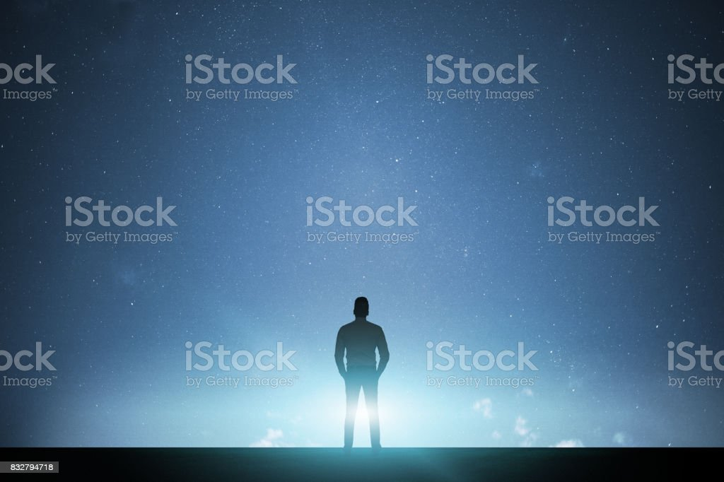 Businessman walking with space light stock photo