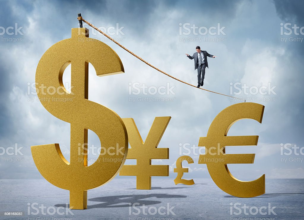 A businessman struggles to walk on a tightrope strung between a...