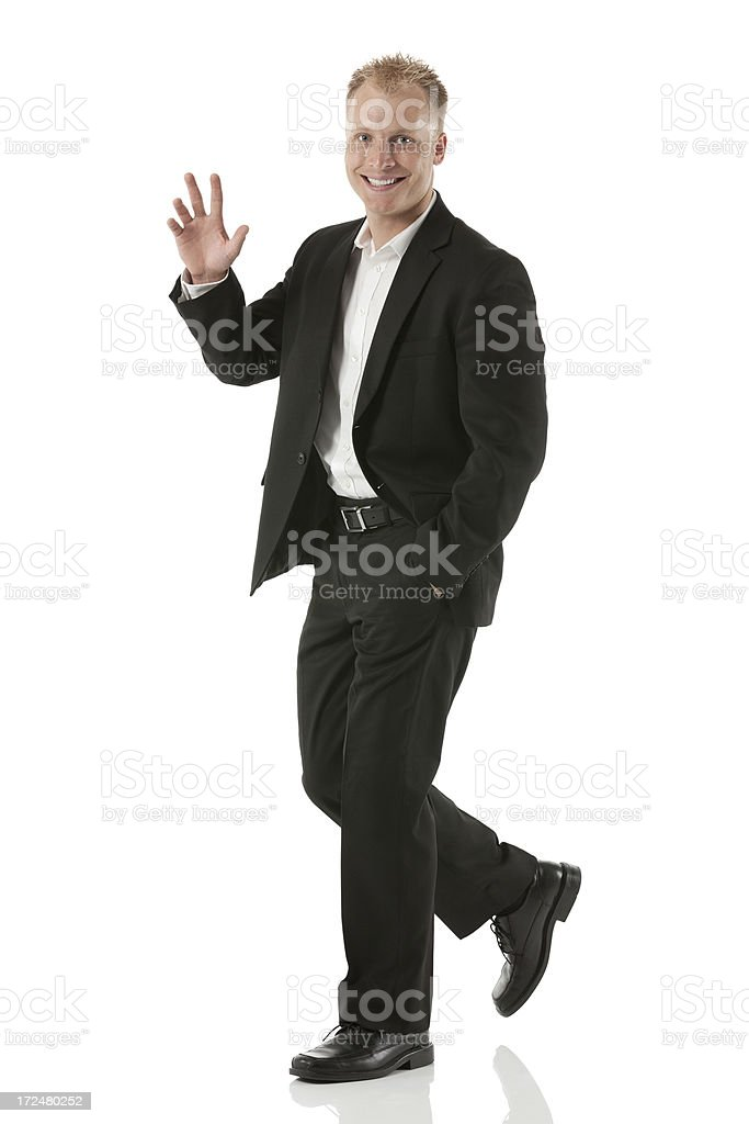 Businessman waving hand royalty-free stock photo
