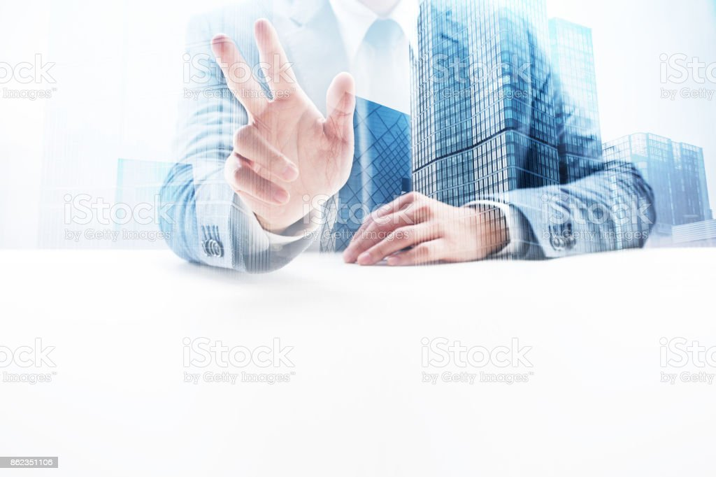 Businessman Waving with Double Exposure Cityscape stock photo