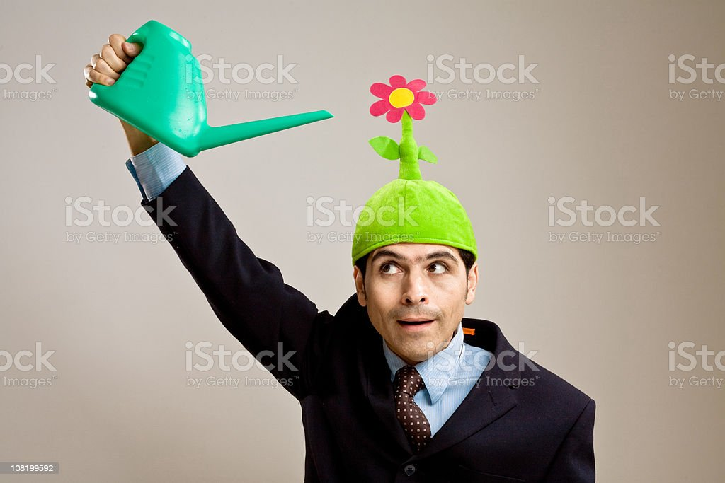Businessman wearing a flower hat stock photo