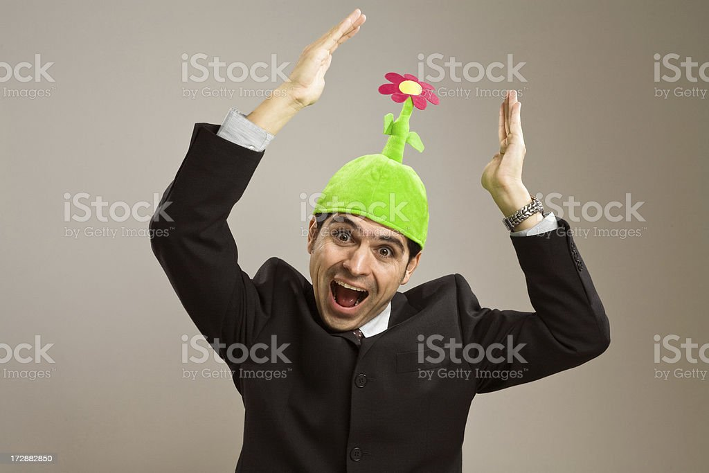 Businessman wearing a flower hat royalty-free stock photo