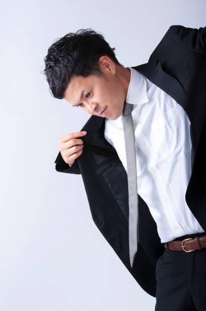 businessman wearing a jacket - 出勤 ストックフォトと画像