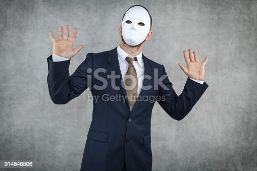 istock businessman wearing a mask 914846506