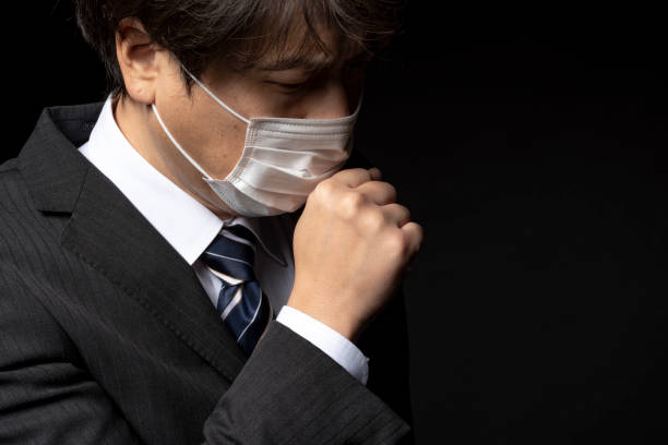 Businessman wearing a medical mask Businessman wearing a medical mask cold virus stock pictures, royalty-free photos & images