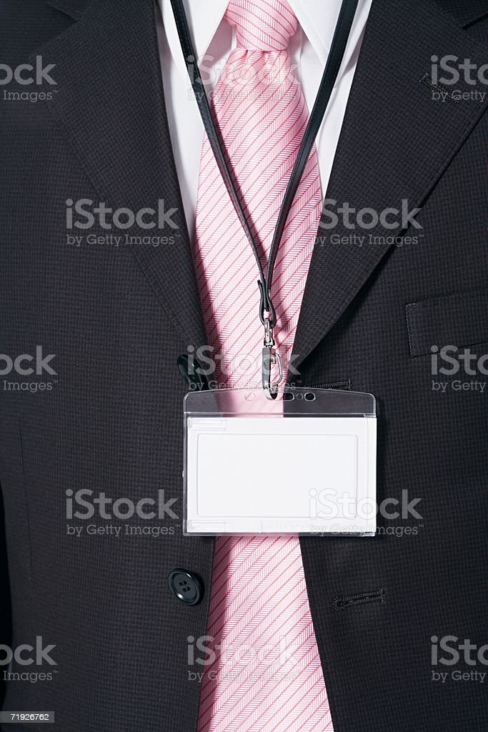 Businessman wearing a security pass stock photo
