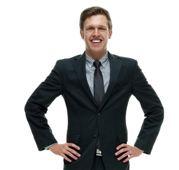 Businessman wearing a suit with necktie and standing on white background Businessman wearing a suit with necktie and standing on white background akimbo stock pictures, royalty-free photos & images