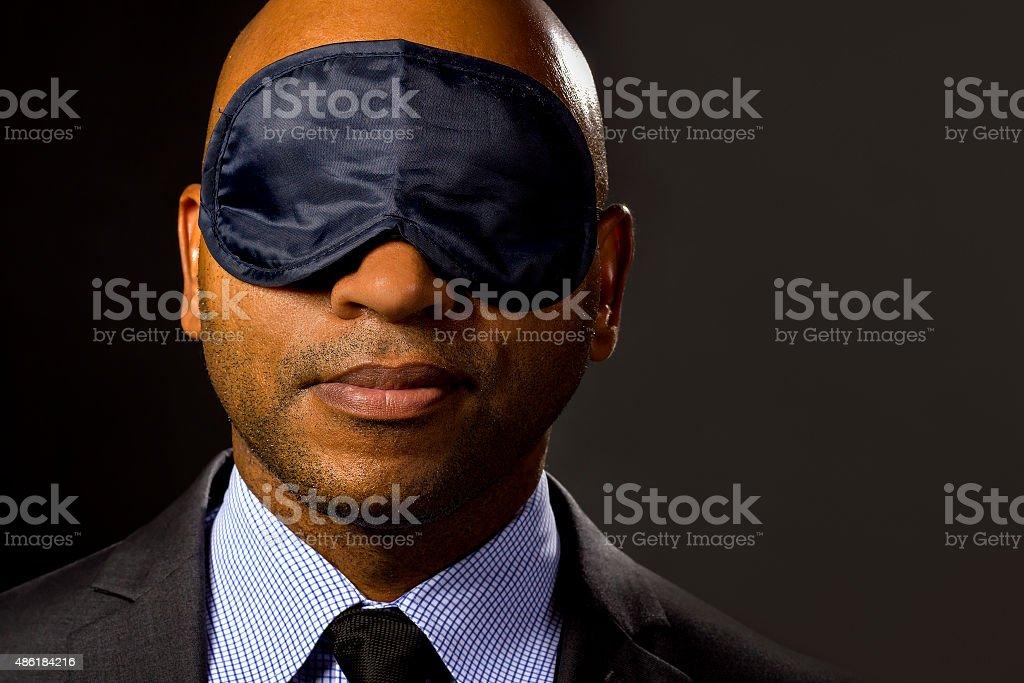 Businessman Wearing an Eye Mask stock photo