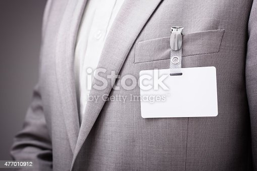 668954740istockphoto Businessman wearing blank name tag 477010912