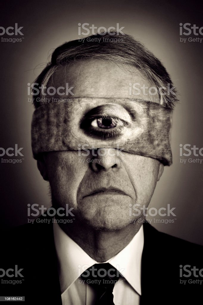 Businessman Wearing Blindfood with One Eye, Black and White royalty-free stock photo