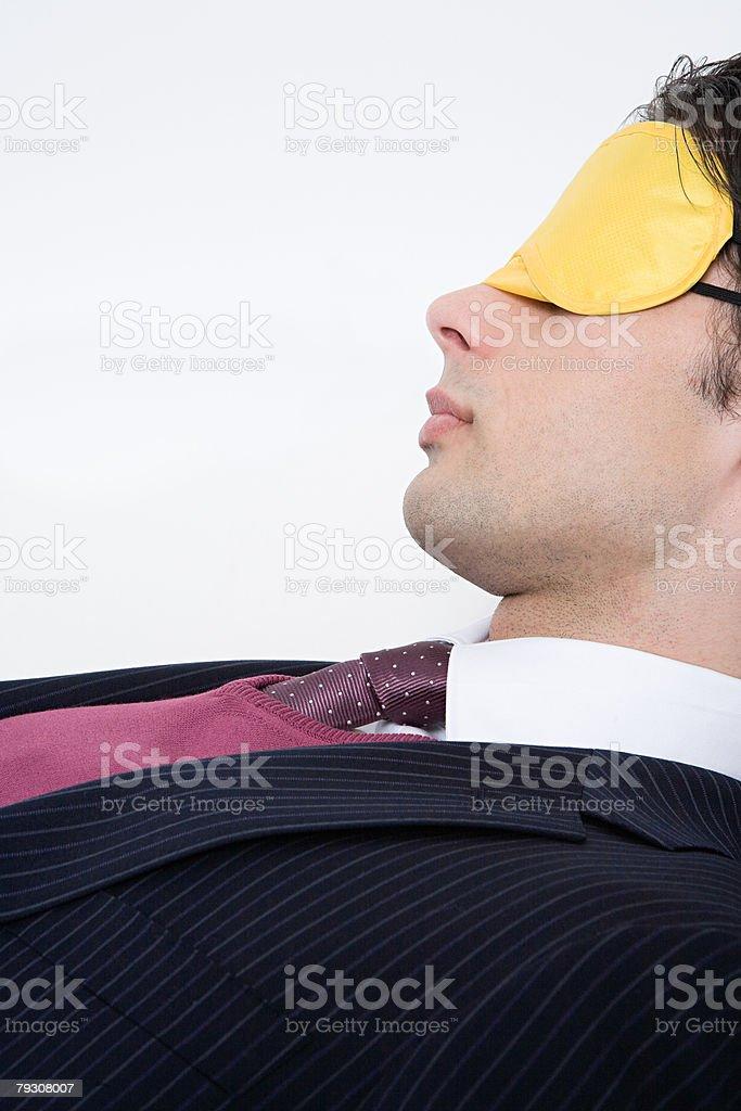 Businessman wearing eye mask 免版稅 stock photo