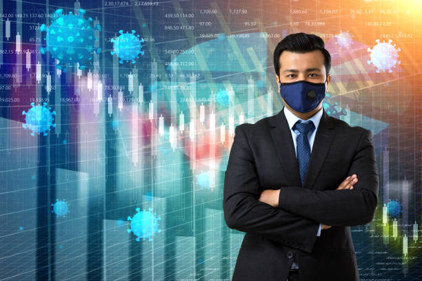 Businessman wearing face mask worried about loss due to impact of pandemic coronavirus stock photo