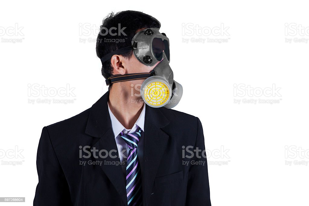 Businessman wearing gas mask isolated Lizenzfreies stock-foto