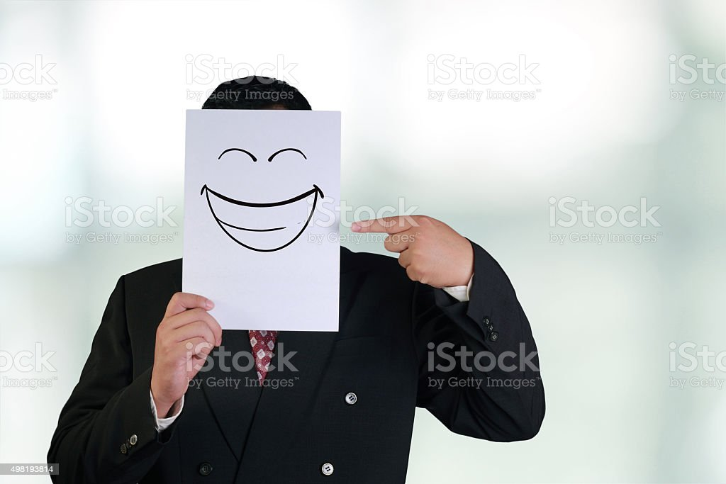 Businessman Wearing Happy Laughing Face Mask stock photo