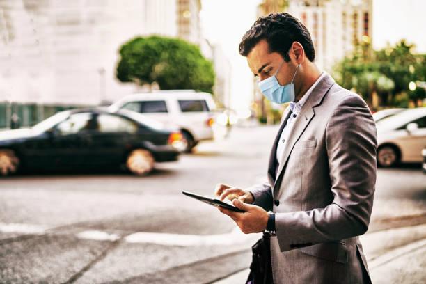 Businessman wearing healthcare mask. stock photo