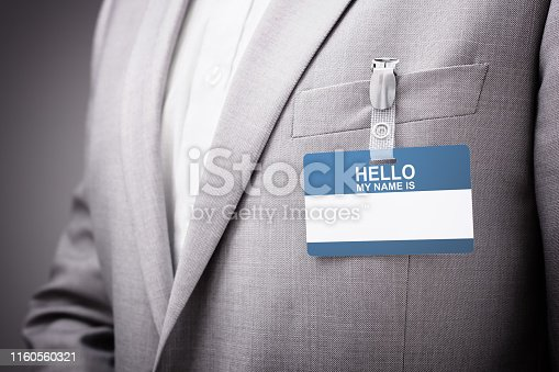 668954740istockphoto Businessman wearing Hello my name is tag 1160560321