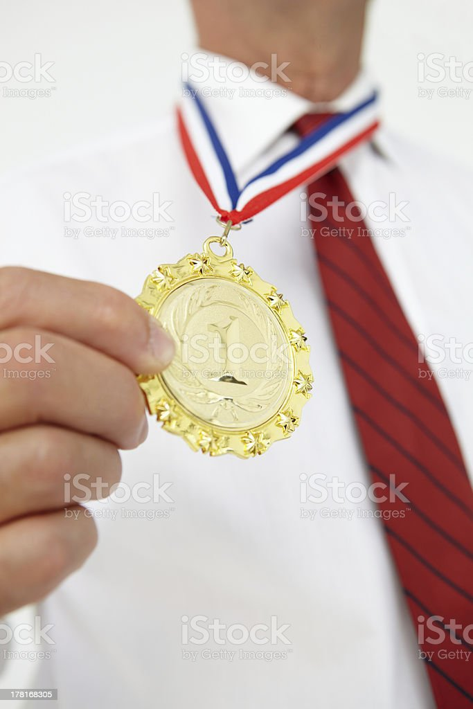 Businessman wearing medal royalty-free stock photo