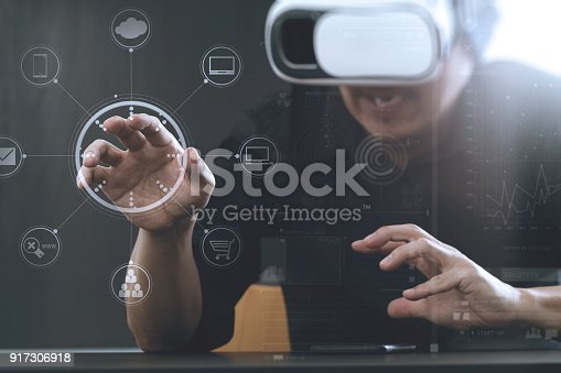 917307226istockphoto businessman wearing virtual reality goggles in modern office with Smartphone using with VR headset 917306918