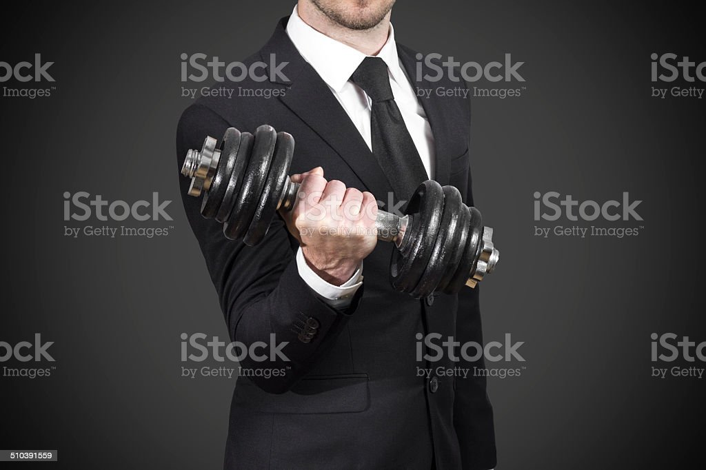 businessman weightlifting stock photo
