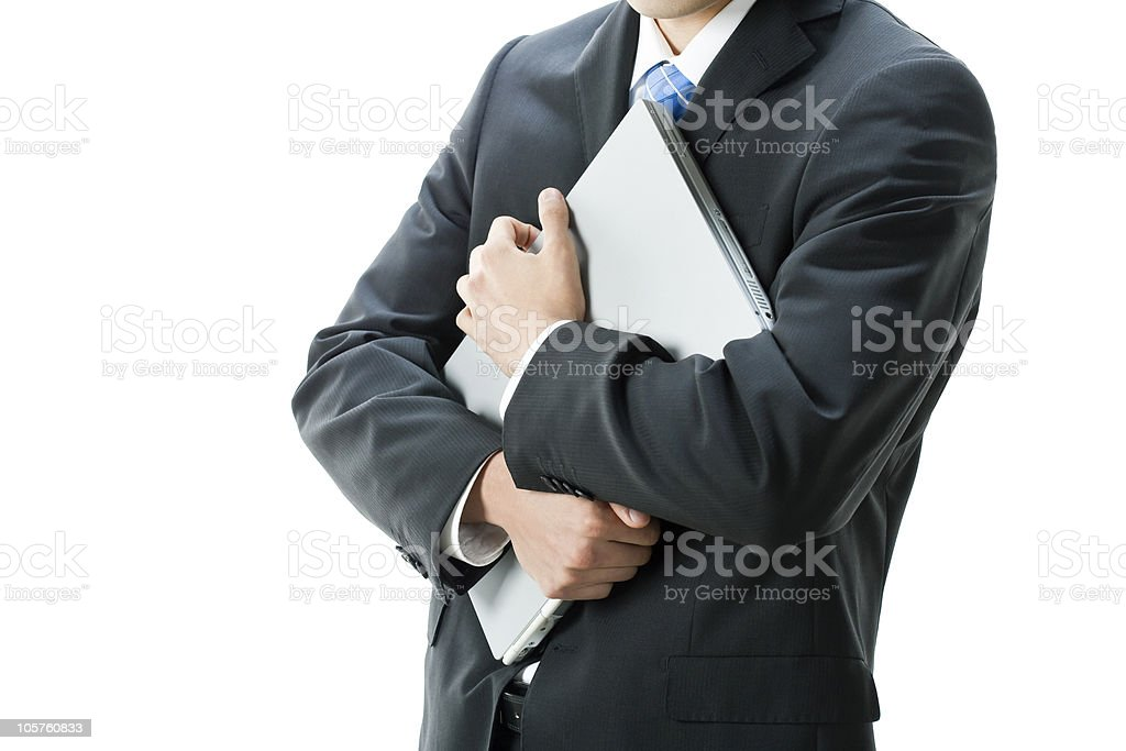 Businessman who defends laptop computer royalty-free stock photo