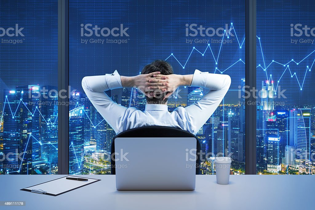 businessman who is looking at the city stock photo