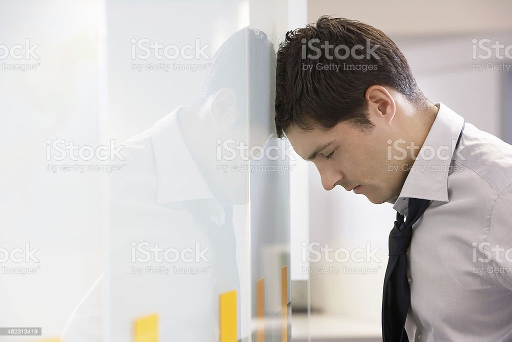 A businessman who is resting his head  stock photo