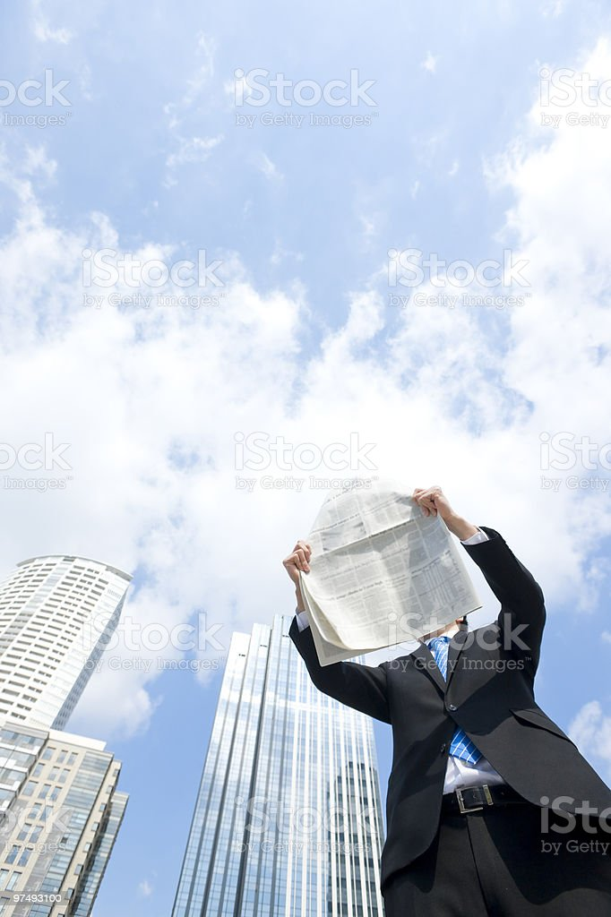 Businessman who reads newspaper royalty-free stock photo