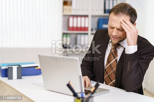 539437954 istock photo Businessman with a bad stress headache 1140394732