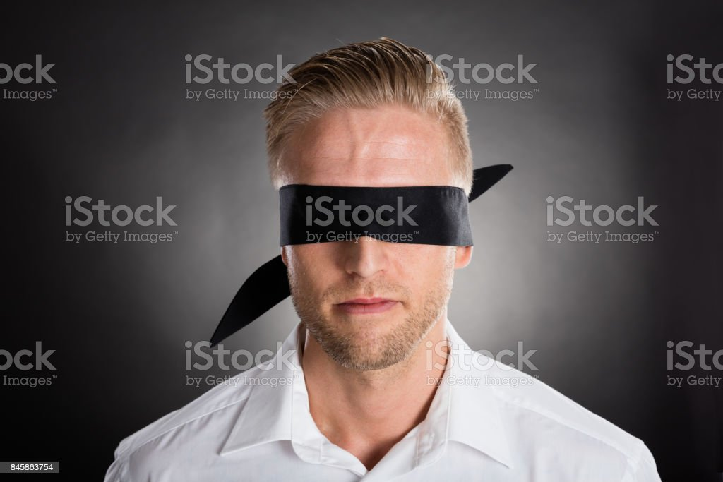 Businessman With A Black Blindfold Over Eyes stock photo