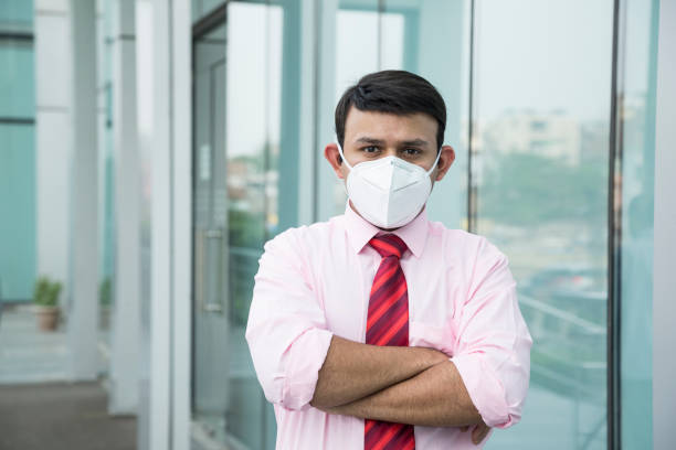 Businessman with a breathing mask isolated - Stock image Pollution Mask, Protective Mask - Workwear, Men, Only Men, Adult pollution mask stock pictures, royalty-free photos & images