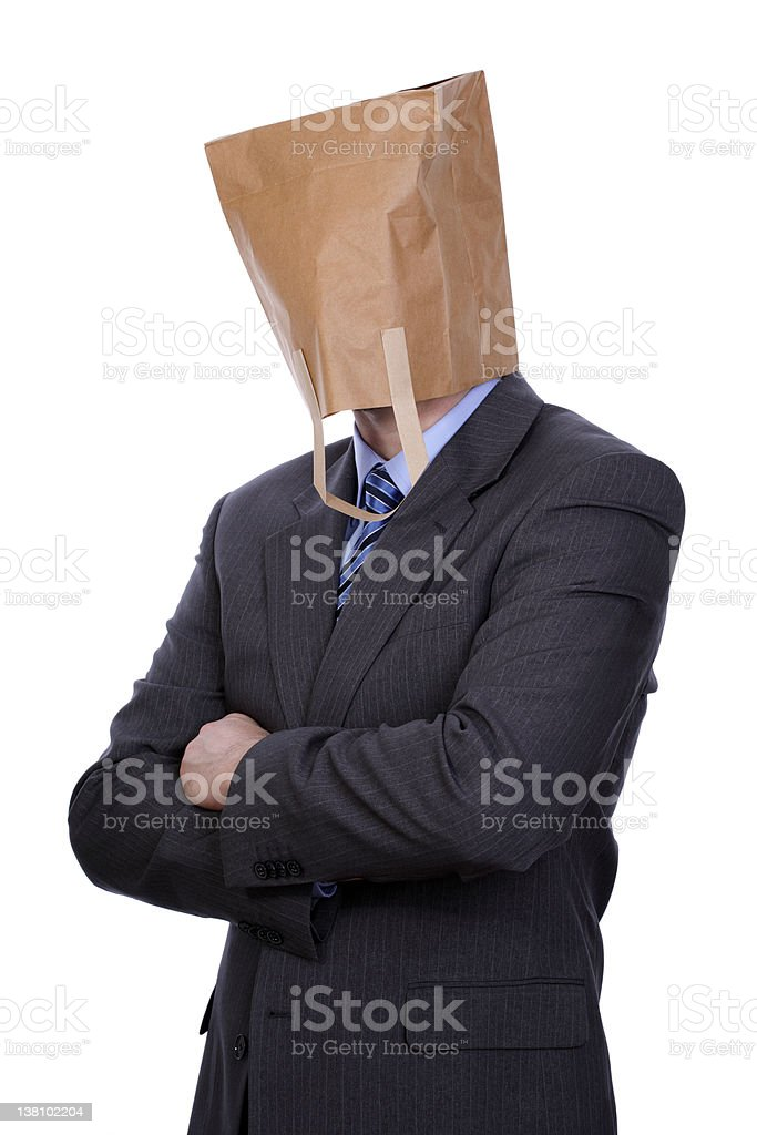 Businessman with a brown paper bag over his head stock photo