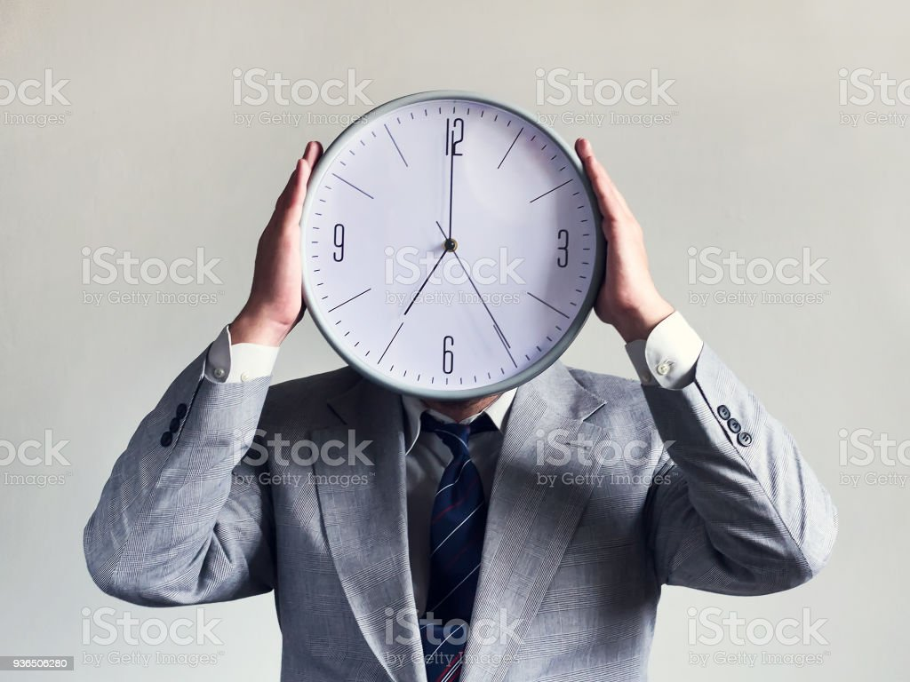 Businessman with a clock instead of a head. Concept business and efficiency. Time and schedule. Money and time. stock photo