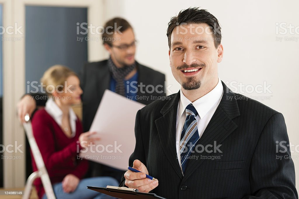 A businessman with a couple in the background royalty-free stock photo
