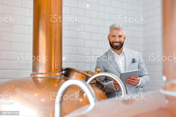 Businessman With A Digital Tablet At Micro Brewery Stock Photo - Download Image Now