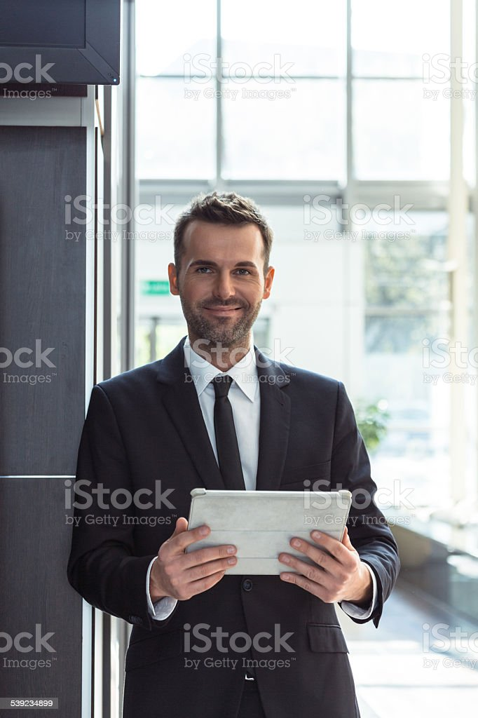 Businessman with a digital tablet stock photo