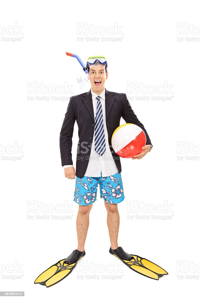 Businessman with a diving mask holding a beach ball stock photo