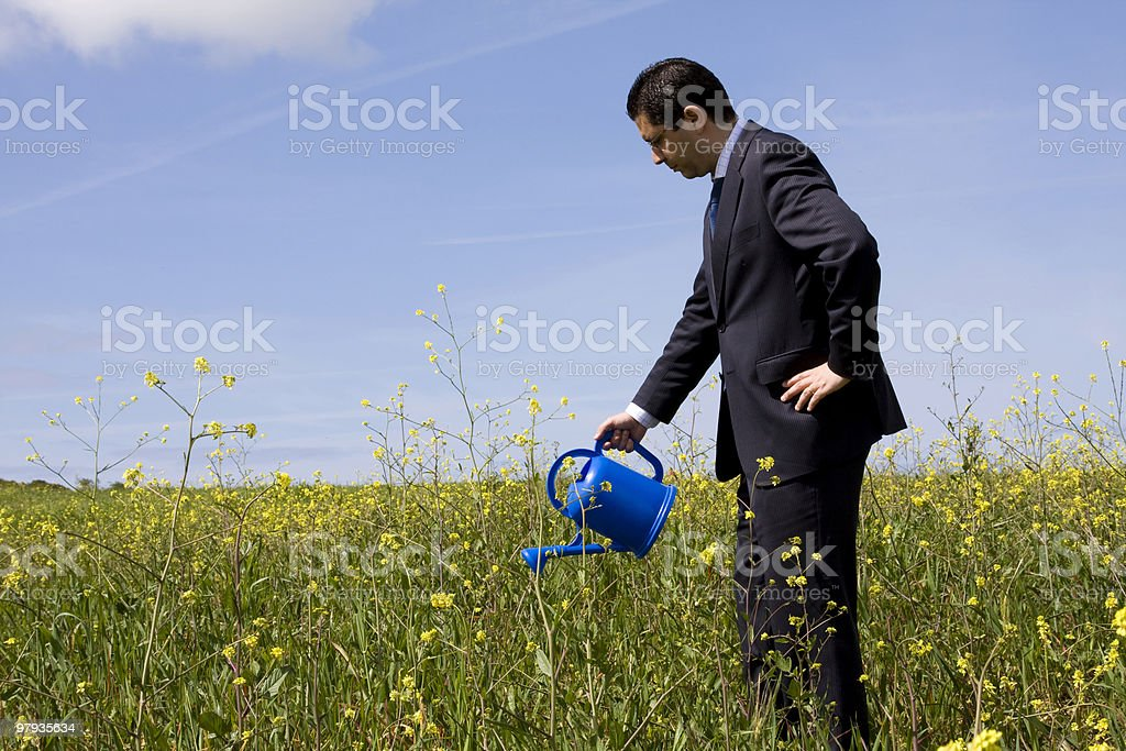 businessman with a flowerpot royalty-free stock photo