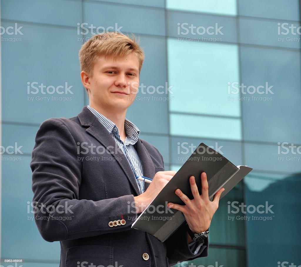 Businessman with a folder on the background of glass Lizenzfreies stock-foto