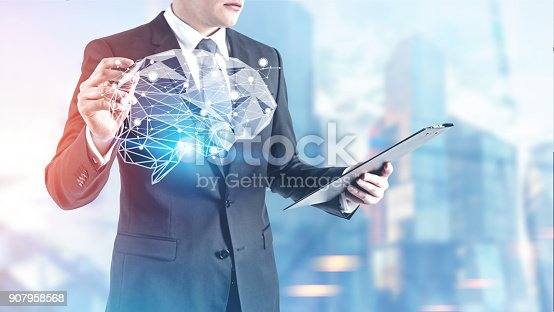 istock Businessman with a glowing marker, brain 907958568