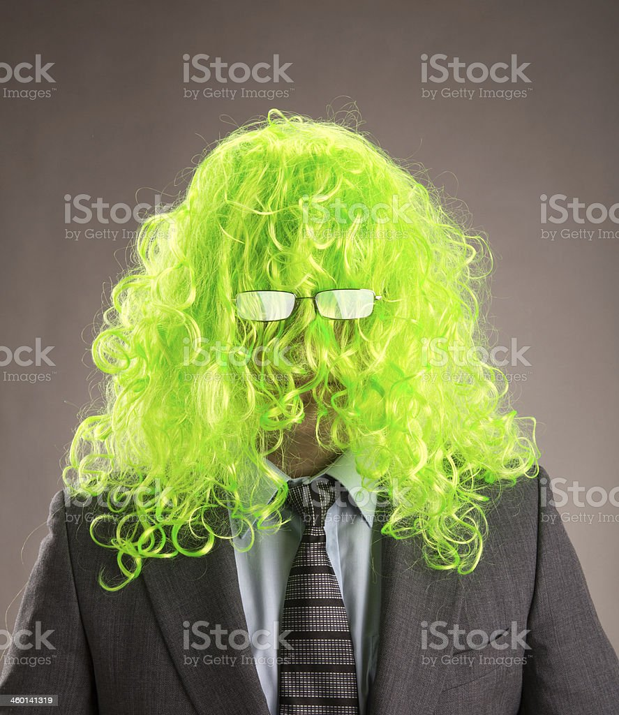 Businessman with a green wig stock photo